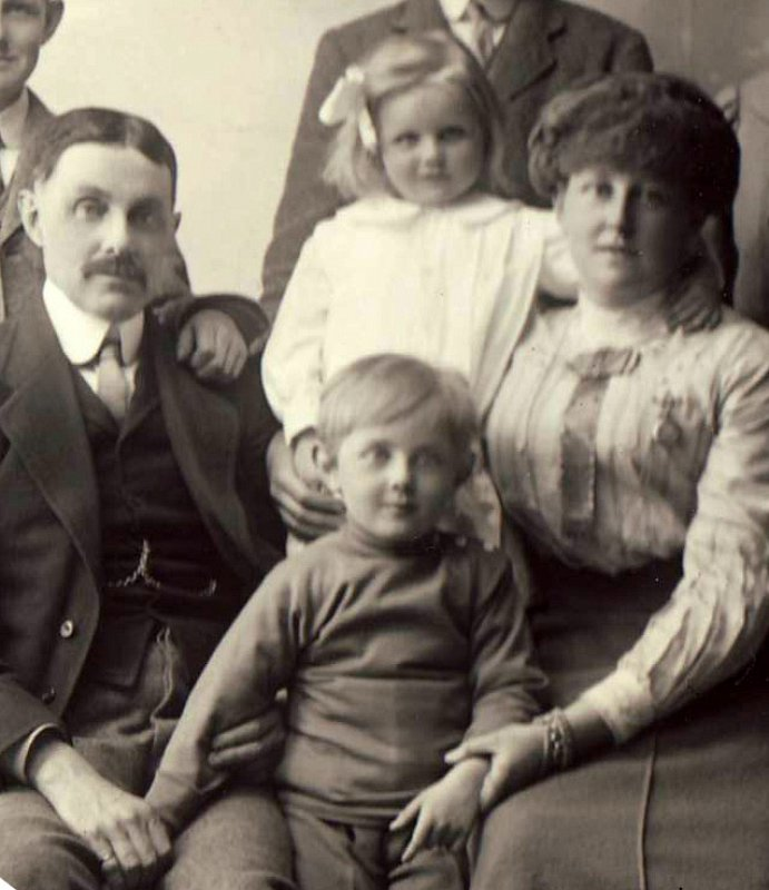 Brian with his parents and sister Mamie